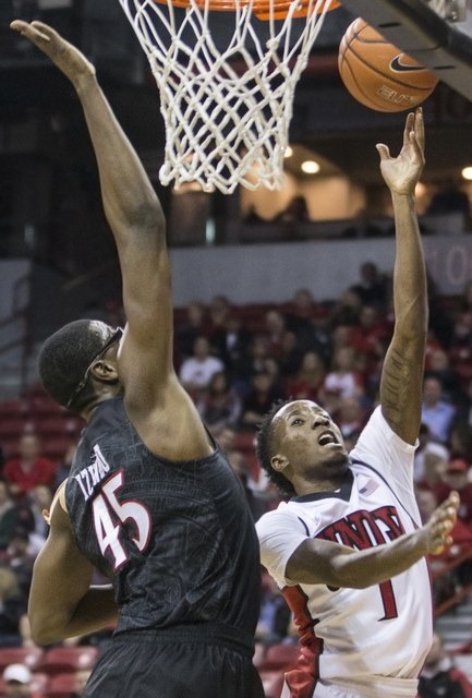 UNLV's Kris Clyburn (1) drives past San Diego State's Valentine Izundu (45) during the Rebels home matchup with the Aztecs on Tuesday, Jan. 17, 2017, at the Thomas & Mack Center, in Las Vegas. ...