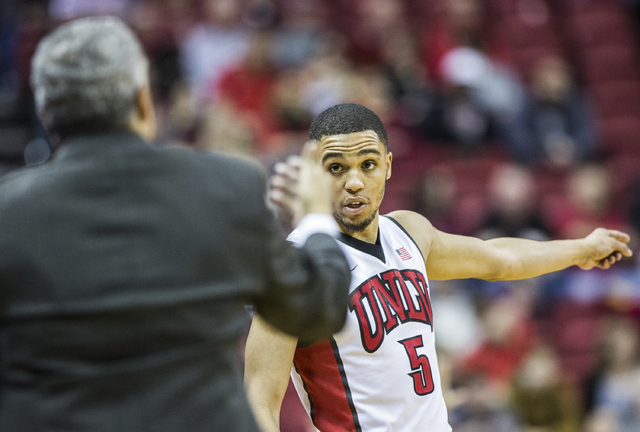 UNLV's Jalen Poyser (5) gets instructions from coach Marvin Menzies during the Rebels home matchup with the Air Force Falcons on Saturday, Jan. 21, 2017, at the Thomas & Mack Center, in Las Ve ...