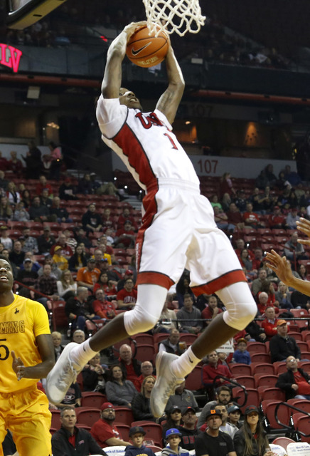 UNLV guard Kris Clyburn (1) grabs a rebound as Wyoming forward during the first half of a NCAA college basketball game against Wyoming at the Thomas & Mack Center on Saturday, Dec. 31, 2016, i ...
