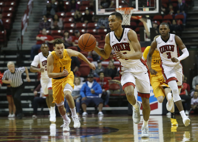 UNLV guard Jalen Poyser (5) drives towards the hoop during the first half of a NCAA college basketball game against Wyoming at the Thomas & Mack Center on Saturday, Dec. 31, 2016, in Las Vegas ...