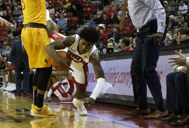 UNLV guard Jovan Mooring (30) is fouled during the first half of a NCAA college basketball game against Wyoming at the Thomas & Mack Center on Saturday, Dec. 31, 2016, in Las Vegas. (Christian ...
