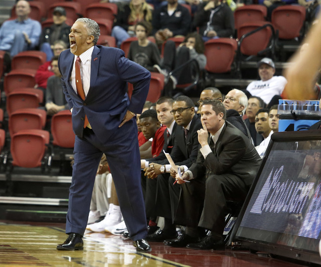 UNLV head coach Marvin Menzies reacts  during the first half of a NCAA college basketball game against Wyoming at the Thomas & Mack Center on Saturday, Dec. 31, 2016, in Las Vegas. (Christian  ...