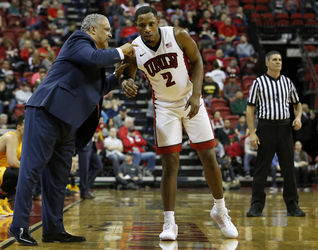 UNLV head coach Marvin Menzies speaks with UNLV guard Uche Ofoegbu (2) during the second half of a NCAA college basketball game against Wyoming at the Thomas & Mack Center on Saturday, Dec. 31 ...