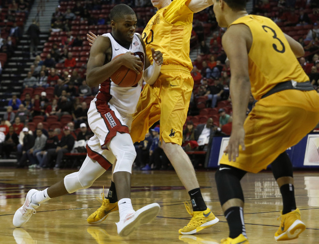 Tyrell Green drives to the basket during the second half of a NCAA college basketball game against Wyoming at the Thomas & Mack Center on Saturday, Dec. 31, 2016, in Las Vegas. UNLV wins 81-75 ...