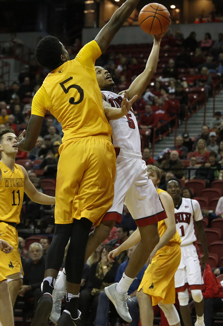 UNLV guard Jalen Poyser (5) shoots a layup during the second half of a NCAA college basketball game against Wyoming at the Thomas & Mack Center on Saturday, Dec. 31, 2016, in Las Vegas. UNLV w ...