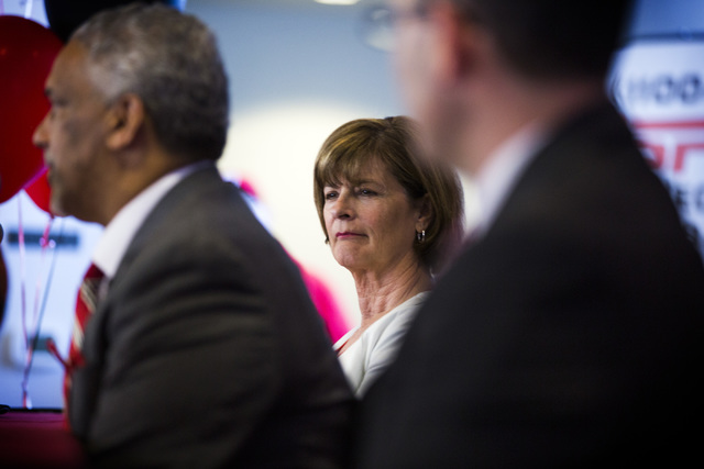 UNLV Director of Athletics Tina Kunzer-Murphy, center,  listens while new UNLV men's basketball coach Marvin Menzies speaks during a press conference at Mendenhall Center on Friday, April 22, 2016 ...