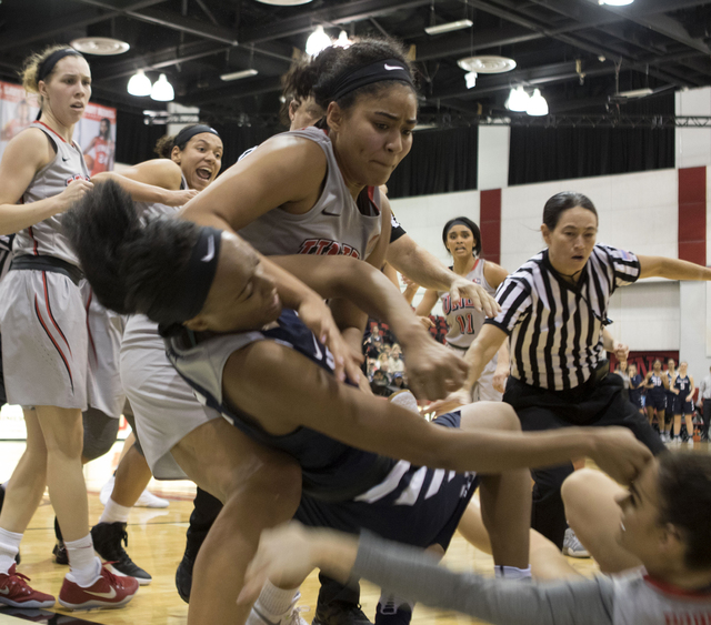 UNLV's Paris Strawther tries to pull the Aggies' Antoina Robinson off of Katie Powell (right) during a third quarter fight at the Cox Pavilion on Jan. 7, 2017. (Heidi Fang/Las Vegas Review-Journal ...