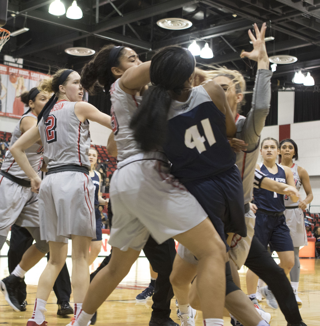Aggies forward Antoina Robinson (no. 41) falls on the basketball court as she and UNLV forward Katie Powell fight during the third quarter of their game at the Cox Pavilion on Jan. 7, 2017. Both p ...