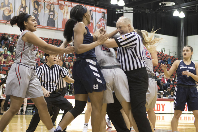 Players from UNLV, Utah State and referees attempt to break up a skirmish in the third quarter between Lady Rebels forward Katie Powell and Aggies forward Antoina Robinson. (Heidi Fang/Las Vegas R ...