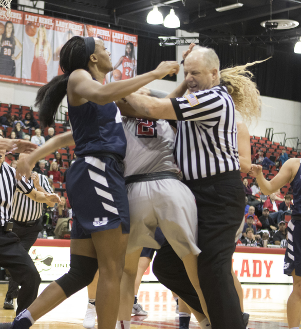 A referee tries to break up a fight in the third quarter at the Cox Pavilion between Antoina Robinson of Utah State and UNLV's Katie Powell on Jan. 7, 2017. (Heidi Fang/Las Vegas Review-Journal) @ ...