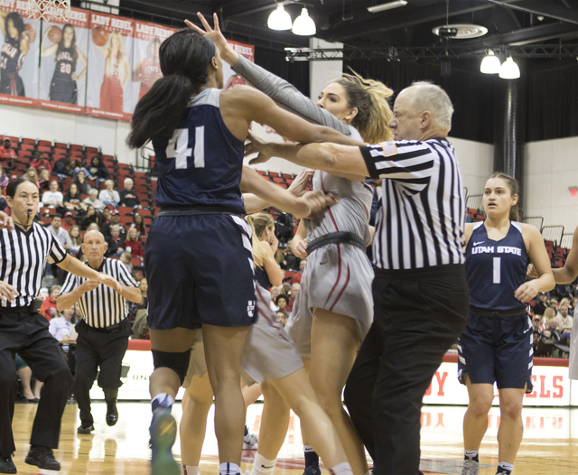 During the third quarter of UNLV vs. Utah State, Aggies forward Antoina Robinson and Lady Rebels forward Katie Powell push and shove each other after a play. (Heidi Fang/Las Vegas Review-Journal)  ...