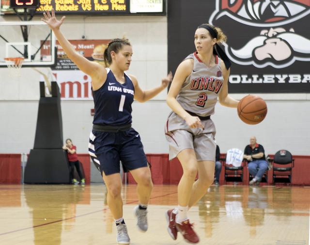 UNLV's Brooke Johnson dribbles past Utah State's Eliza West at the Cox Pavilion on Jan. 7, 2017. (Heidi Fang/Las Vegas Review-Journal) @HeidiFang