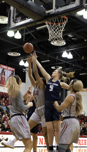 Utah State's Shannon Dufficy goes for a rebound after the Lady Rebels miss a shot at the Cox Pavilion on Jan. 7, 2017. (Heidi Fang/Las Vegas Review-Journal) @HeidiFang