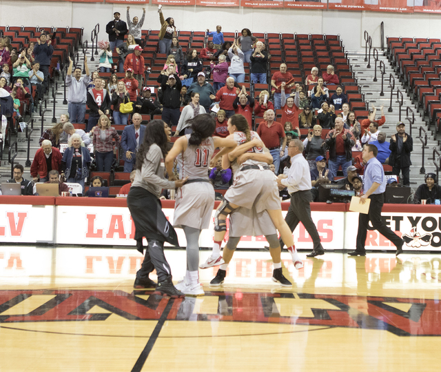 The Lady Rebels celebrate their overtime win over the Aggies, 55-53, at the Cox Pavilion on Jan. 7, 2017. (Heidi Fang/Las Vegas Review-Journal) @HeidiFang