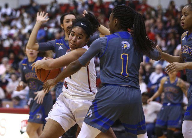 UNLV's Paris Strawther (3) drives to the basket against San Jose State guard Myzhanique Ladd (1) during a basketball game at the Cox Pavilion in Las Vegas on Saturday, Jan. 28, 2017. San Jose Stat ...