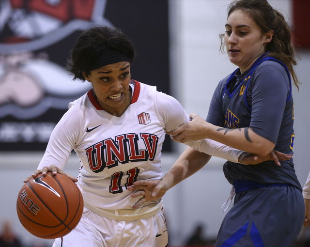 UNLV's Dakota Gonzalez (12) drives past San Jose State guard Taylor Turney (30) during a basketball game at the Cox Pavilion in Las Vegas on Saturday, Jan. 28, 2017. San Jose State won 76-65. (Cha ...