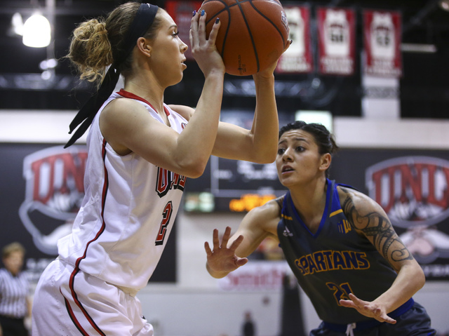 UNLV's Brooke Johnson (2) looks to get past San Jose State guard Dezz Ramos (21) during a basketball game at the Cox Pavilion in Las Vegas on Saturday, Jan. 28, 2017. San Jose State won 76-65. (Ch ...
