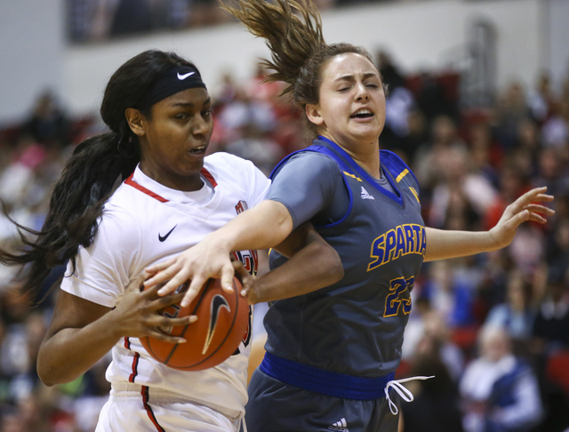 UNLV's Jordyn Bell (23), left, gets a rebound over San Jose State forward Hallie Gennett (23) during a basketball game at the Cox Pavilion in Las Vegas on Saturday, Jan. 28, 2017. San Jose State w ...