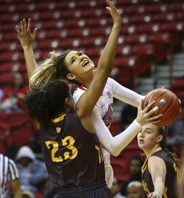 UNLV's Katie Powell (21) shoots over Wyoming forward Bailee Cotton (23) during a basketball game at the Thomas & Mack Center in Las Vegas on Wednesday, Jan. 25, 2017. UNLV won 51-46. (Chase St ...