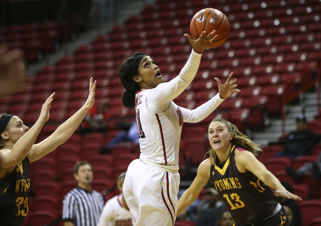 UNLV's Dylan Gonzalez (11) goes up for a shot as Wyoming guard Liv Roberts (13) looks on during a basketball game at the Thomas & Mack Center in Las Vegas on Wednesday, Jan. 25, 2017. UNLV won ...