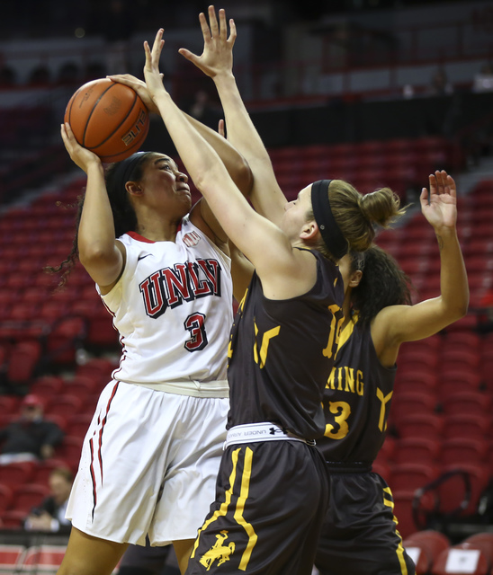 UNLV's Paris Strawther (3) shoots over Wyoming defenders during a basketball game at the Thomas & Mack Center in Las Vegas on Wednesday, Jan. 25, 2017. UNLV won 51-46. (Chase Stevens/Las Vegas ...