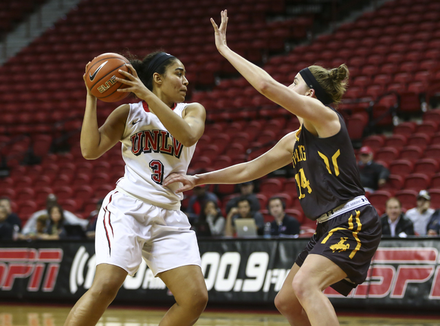 UNLV's Paris Strawther (3) drives against Wyoming forward Natalie Baker (14) during a basketball game at the Thomas & Mack Center in Las Vegas on Wednesday, Jan. 25, 2017. UNLV won 51-46. (Cha ...