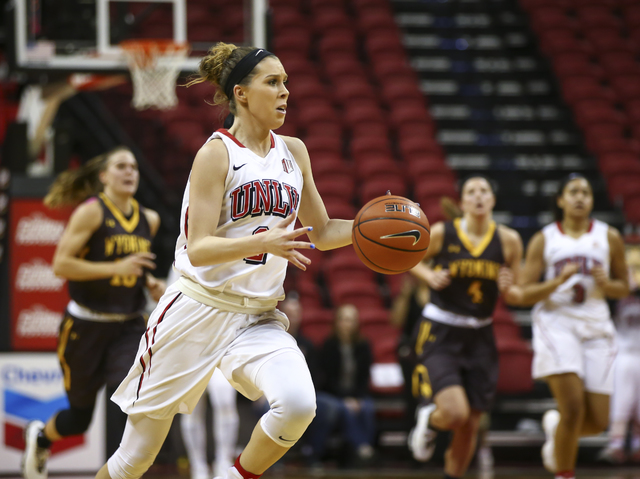 UNLV's Brooke Johnson (2) drives against Wyoming during a basketball game at the Thomas & Mack Center in Las Vegas on Wednesday, Jan. 25, 2017. UNLV won 51-46. (Chase Stevens/Las Vegas Review- ...