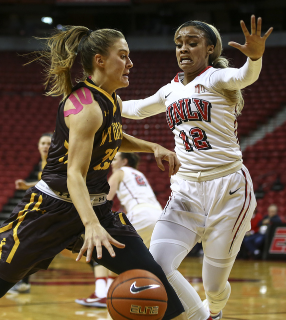 Wyoming guard Liv Roberts (13) drives against UNLV's Dakota Gonzalez (12) during a basketball game at the Thomas & Mack Center in Las Vegas on Wednesday, Jan. 25, 2017. (Chase Stevens/Las Vega ...