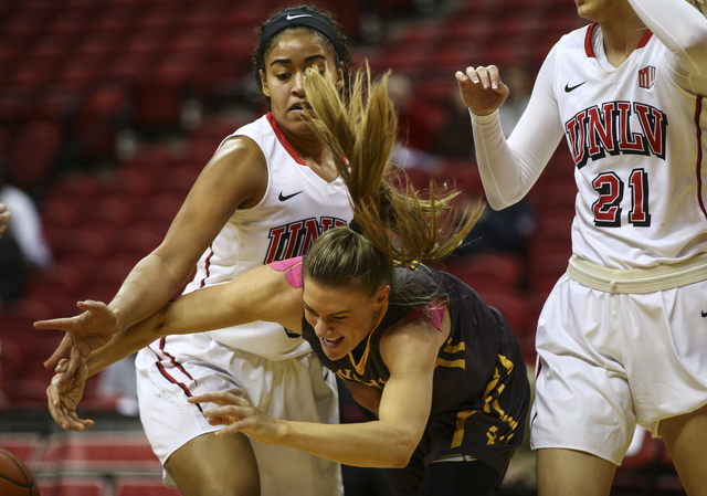 Wyoming guard Liv Roberts (13) loses control of the ball as UNLV's Paris Strawther (3) looks on during a basketball game at the Thomas & Mack Center in Las Vegas on Wednesday, Jan. 25, 2017. ( ...