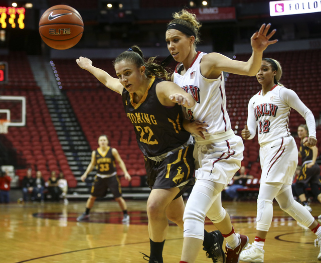 Wyoming guard Clara Tapia (22) and UNLV's Brooke Johnson (2) watch as the ball goes out of bounds during a basketball game at the Thomas & Mack Center in Las Vegas on Wednesday, Jan. 25, 2017. ...