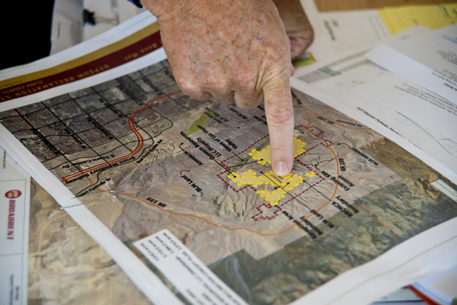Ron Krater points to the site of a proposed community at the Blue Diamond Hill Gypsum mine near the town of Blue Diamond on Thursday, Aug. 11, 2016. (Daniel Clark/Las Vegas Review-Journal) Follow  ...