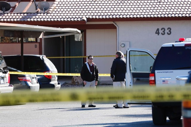 Las Vegas police officers investigate at 433 N. Lamb Blvd. near Stewart Avenue where a body was found Monday, Jan. 16, 2017. Homicide detectives were called out because the victim was in her early ...