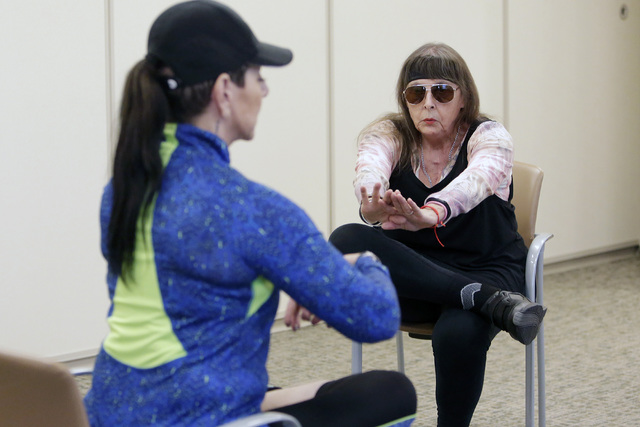 Annie Shattuck, instructor, left, works with Ruth Matte, 73, during an exercise session called ForeverFit at the Southwest Medical Associates Lifestyle Center, Thursday, Oct. 6, 2016. Bizuayehu Te ...