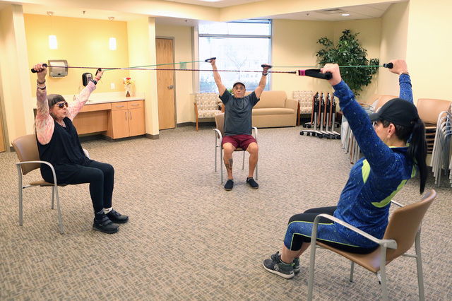 Annie Shattuck, instructor, center, works with Ruth Matte, 73, left, and Harry Zaya, 65, with resistance bands during an exercise session called ForeverFit at the Southwest Medical Associates Life ...