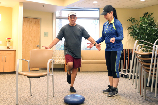 Annie Shattuck, instructor, right, works with Harry Zayas, 65, on his balance during an exercise session called ForeverFit at the Southwest Medical Associates Lifestyle Center, Thursday, Oct. 6, 2 ...