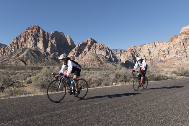 Donna, left, and Curtis Ingle bike at Red Rock Canyon National Conservation Area in Las Vegas on Nov. 2, 2016. (Jason Ogulnik/Las Vegas Review-Journal)