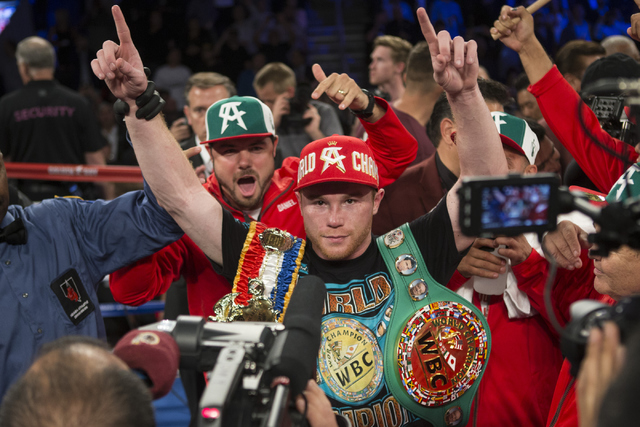 "Saul ""Canelo"" Alvarez raises his arm in victory after his victory against Amir Khan in the WBC Middleweight Title bout at the T-Mobile Arena on Saturday, May 7, 2016, in Las Vegas. (Erik Verdu ..."