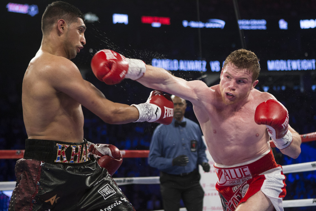 "Saul ""Canelo"" Alvarez, right, throws a right punch against Amir Khan in the WBC Middleweight Title bout at the T-Mobile Arena on Saturday, May 7, 2016, in Las Vegas. Alvarez won by way of knoc ..."