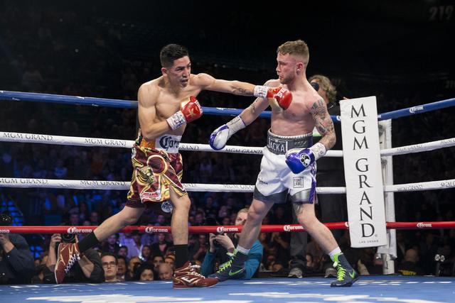 Leo Santa Cruz, left, throws a punch against Carl Frampton in the WBA Featherweight Championship bout in the WBA Featherweight Championship bout at MGM Grand Garden Arena on Saturday, Jan. 28, 201 ...