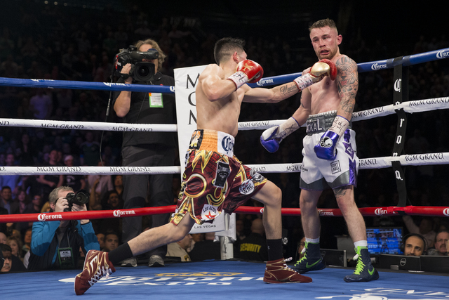 Leo Santa Cruz, left, connects a punch against Carl Frampton in the WBA Featherweight Championship bout at MGM Grand Garden Arena on Saturday, Jan. 28, 2017, in Las Vegas. Santa Cruz won by split  ...
