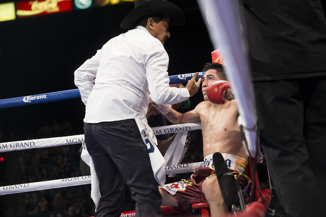 Leo Santa Cruz, right, receives advice in between rounds from his father Jose in his fight against Carl Frampton in the WBA Featherweight Championship bout at MGM Grand Garden Arena on Saturday, J ...
