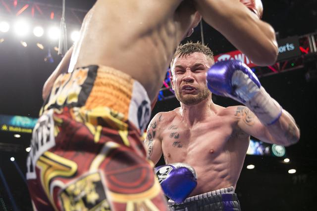 Leo Santa Cruz, left, battles Carl Frampton in the WBA Featherweight Championship bout at MGM Grand Garden Arena on Saturday, Jan. 28, 2017, in Las Vegas. Santa Cruz won by split decision. (Erik V ...