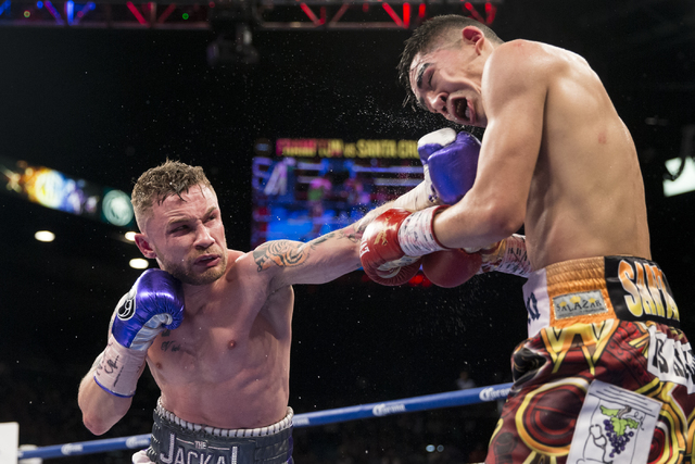 Carl Frampton, left, connects a punch against Leo Santa Cruz in the WBA Featherweight Championship bout at MGM Grand Garden Arena on Saturday, Jan. 28, 2017, in Las Vegas. Santa Cruz won by split  ...