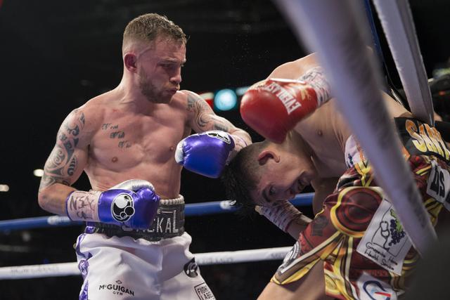 Carl Frampton, left, battles Leo Santa Cruz in the WBA Featherweight Championship bout at MGM Grand Garden Arena on Saturday, Jan. 28, 2017, in Las Vegas. Santa Cruz won by split decision. (Erik V ...