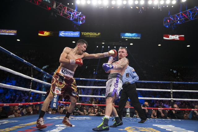 Leo Santa Cruz, left, throws a punch against Carl Frampton in the WBA Featherweight Championship bout at MGM Grand Garden Arena on Saturday, Jan. 28, 2017, in Las Vegas. Santa Cruz won by split de ...