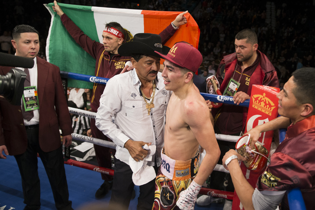 Leo Santa Cruz, right, embraces his father Jose after his fight against Carl Frampton in the WBA Featherweight Championship bout at MGM Grand Garden Arena on Saturday, Jan. 28, 2017, in Las Vegas. ...