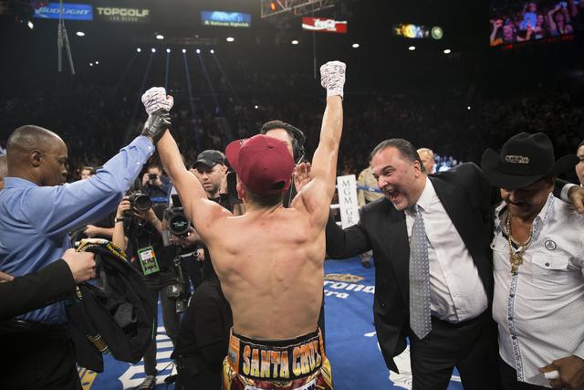Leo Santa Cruz celebrates his split decision win against Carl Frampton in the WBA Featherweight Championship bout at MGM Grand Garden Arena on Saturday, Jan. 28, 2017, in Las Vegas. (Erik Verduzco ...