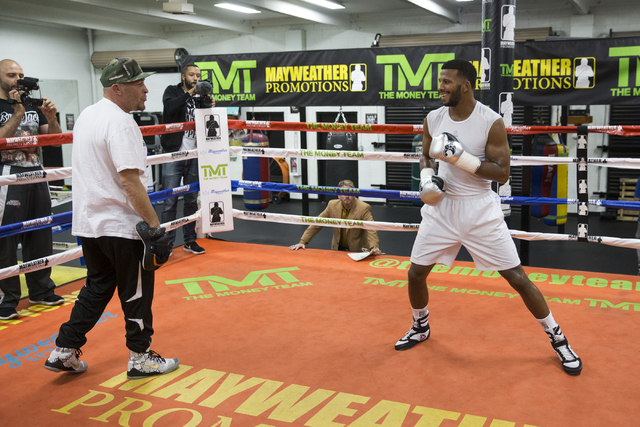 Las Vegas resident and professional boxer Badou Jack, right, with his trainer Louis Delvalle during a media day workout at the Mayweather Boxing Club on Thursday, Jan. 5, 2017, in Las Vegas. Erik  ...