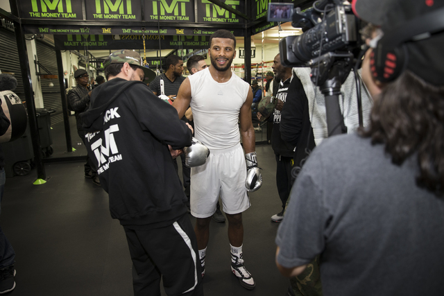 Las Vegas resident and professional boxer Badou Jack, right, with his trainer Louis Delvalle during a media day workout at the Mayweather Boxing Club on Thursday, Jan. 5, 2017, in Las Vegas. (Erik ...
