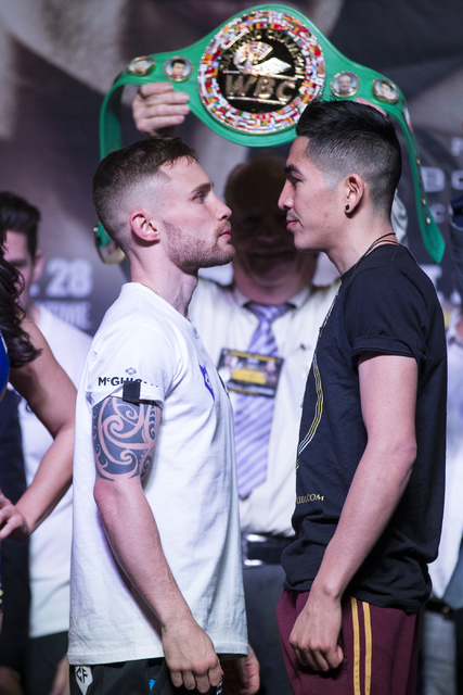 Carl Frampton, left, and Leo Santa Cruz during a boxing weigh-in event at the MGM Grand Garden Arena on Friday, Jan. 27, 2017, in Las Vegas. Frampton and Santa Cruz will fight in the WBA Super Wor ...